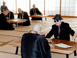 A Buddhist monk faces off with a police official playing the role of a yakuza extortionist during an  antigang drill in December at Chionin Temple in Kyoto.