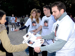 Paul Dingwell hands out leaflets Sunday in Tokyo's Harajuku district, urging people to share any information that could lead to the arrest of Tatsuya Ichihashi, who is wanted in the March slaying of Lindsay Ann Hawker