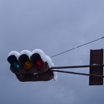 Snow ornaments on traffic lights